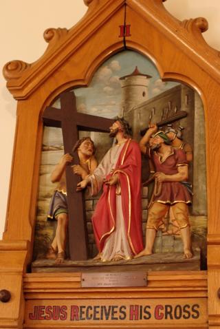 Jesus receives his Cross